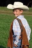 Smiling Cowboy. A portrait of a cute smiling boy dressed up like a cowboy stock images
