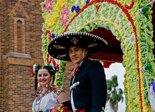 Smiling cowboy and girl on parade float royalty free stock photo