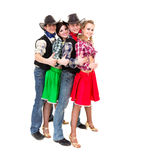 Smiling cowboys and cowgirls with thumbs up Royalty Free Stock Images
