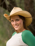 Smiling Cowgirl. Smiling young lady in cowboy hat Royalty Free Stock Image