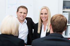 Smiling coworkers in a business meeting Royalty Free Stock Images