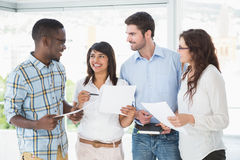 Smiling coworkers with files briefing together Stock Photos