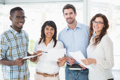 Smiling coworkers holding files and posing Royalty Free Stock Photography