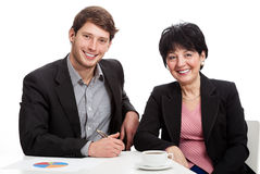 Smiling coworkers during job Royalty Free Stock Photos
