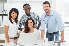 Smiling coworkers looking at camera Royalty Free Stock Photos