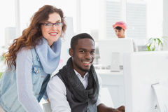 Smiling coworkers looking at camera together Stock Images