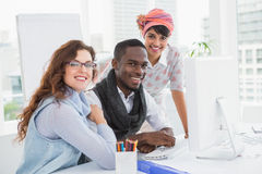 Smiling coworkers posing and looking at camera Royalty Free Stock Photo