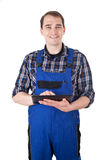 Smiling craftsman with digital tablet Royalty Free Stock Photo