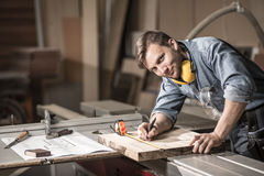 Smiling craftsman during his work Royalty Free Stock Photography