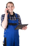 Smiling craftsman with mobile phone and digital tablet Royalty Free Stock Photos