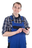 Smiling craftsman with smart phone Royalty Free Stock Images