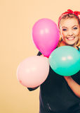 Smiling crazy girl having fun with balloons. Stock Images