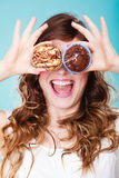 Smiling crazy woman holds cakes in hand Royalty Free Stock Photography