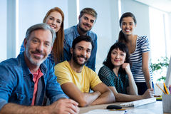Smiling creative business team working together at desk in office Royalty Free Stock Photography