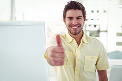 Smiling creative businessman by his desk Royalty Free Stock Photo
