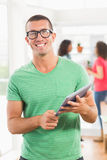 Smiling creative businessman looking at the camera Stock Photos
