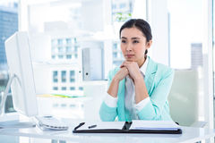 Smiling creative businesswoman by her desk Royalty Free Stock Photos
