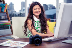 Smiling creative businesswoman using computer Royalty Free Stock Photos