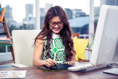 Smiling creative businesswoman using digital board Stock Photos