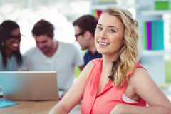 Smiling creative businesswoman working with co-workers royalty free stock photos