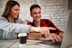 Creative couple designers finishing design project Royalty Free Stock Photography
