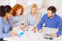 Smiling creative team looking at sketch Royalty Free Stock Photo