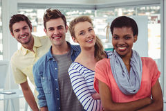 Smiling creative team standing in a line Stock Photography