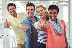 Smiling creative team standing in a line Stock Photos