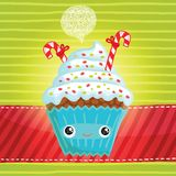 Smiling cupcake Stock Images