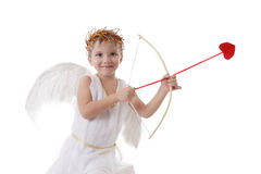 Smiling cupid boy aiming arrow Royalty Free Stock Photos