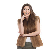 Smiling And Curious Girl In Fur Vest Sideways Glance Stock Photos