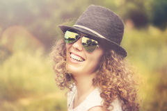 Smiling curly girl Royalty Free Stock Photos