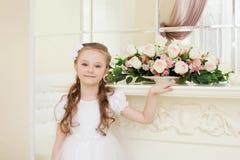 Smiling curly girl posing looking at camera Royalty Free Stock Image
