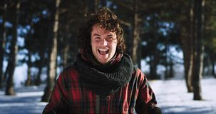 Smiling curly hair man tourist in front of the camera happy enjoying the time on the winter day in front of the camera. Portrait stock footage