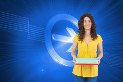 Smiling curly haired brunette holding notebooks Royalty Free Stock Photo