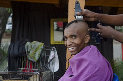Smiling customer African haircut barber business Stock Photo