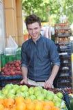 Smiling customer buying fruits Royalty Free Stock Photos