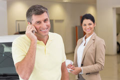 Smiling customer calling with his mobile phone Stock Photography