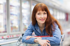 Smiling customer crossing the frozen aisle Royalty Free Stock Photos
