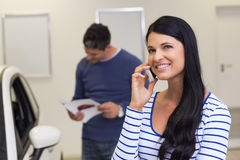 Smiling customer making a phone call Royalty Free Stock Images