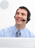 Smiling customer service agent with headset on. Against white background stock photography