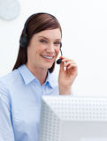 Smiling customer service agent with headset on Royalty Free Stock Photography