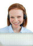 Smiling customer service agent with headset on Royalty Free Stock Images