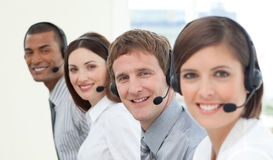 Smiling customer service agents with headset on Stock Photography