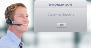 Smiling customer service executive wearing headphones by dialog box. Digital composite of Smiling customer service executive wearing headphones by dialog box Stock Photos