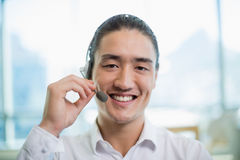 Smiling customer service executive working in call center Royalty Free Stock Image