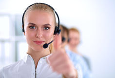 Smiling customer service girl showing ok, isolated Royalty Free Stock Photography