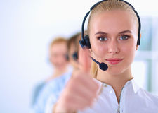Smiling customer service girl showing ok, isolated Stock Photography