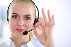 Smiling customer service girl showing ok,  Stock Photos