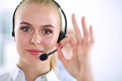 Smiling customer service girl showing ok,. A smiling customer service girl showing ok,  on white background Stock Photos